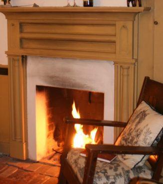 rocker in front of blazing fireplace