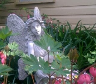 white angel among pink flowers