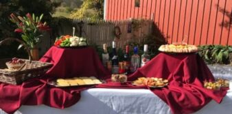 food set on tables with red cloth