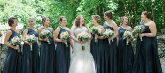 bridal party with bride, all smiling