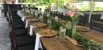 wood table set with pink roses in vases