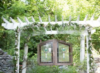 white arbor with stained glass