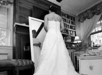 bride looking at herself in mirror