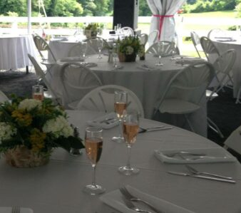 tables with white tablecloths and glasses of champagne