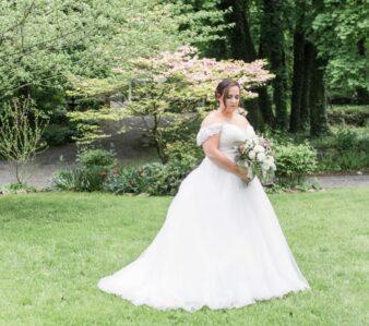 bride looking at floral bouquet