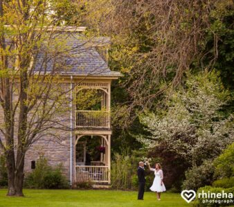 side view of inn with bride and groom