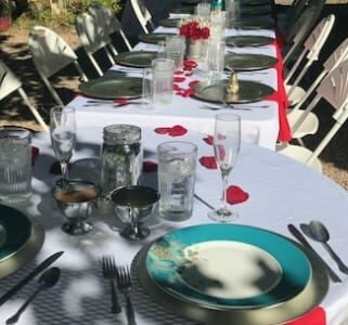 table setup with white and red tablecloths