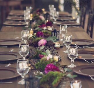 table setup with pink flowers in runner