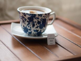 blue cup and saucer with tea
