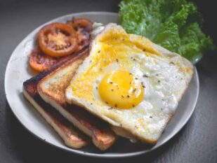 egg over toast with tomatoes and lettuce