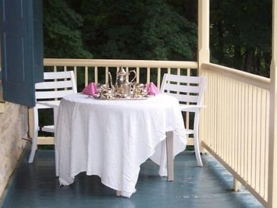 porch with table with white tablecloth