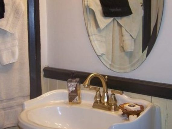 white bathroom sink with mirror above