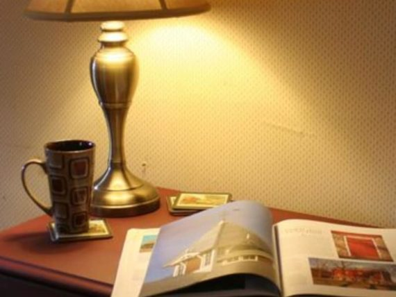 lamp on dresser with book and coffee cup